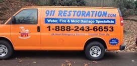 Water Damage Restoration Van At Fall Residential Job Site With Fallen Leaves